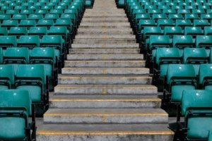 3882117-numbered-steps-in-a-sports-stadium-in-between-the-green-pastic-seating